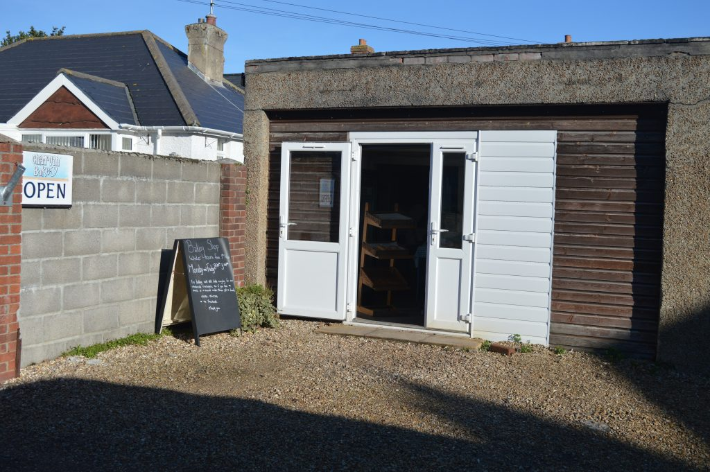 Charmouth Bakery on your left.  Lovely products, but not always open